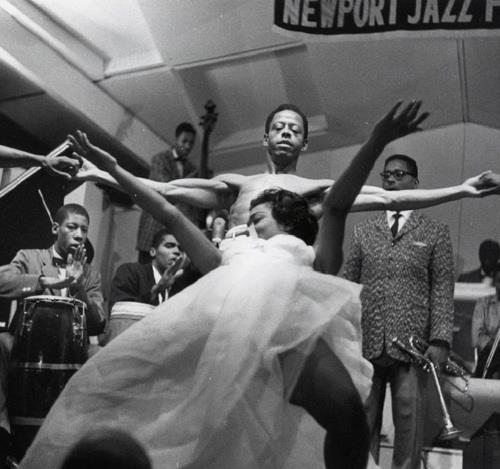 Eartha Kitt dances during Dizzy Gillespie's set at the Newport Jazz Festival (1954)