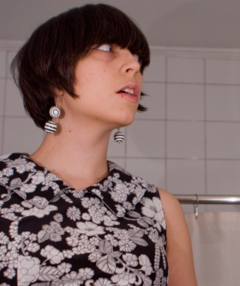 self-portrait in the bathroom - mod 1960s black and white dress and earrings