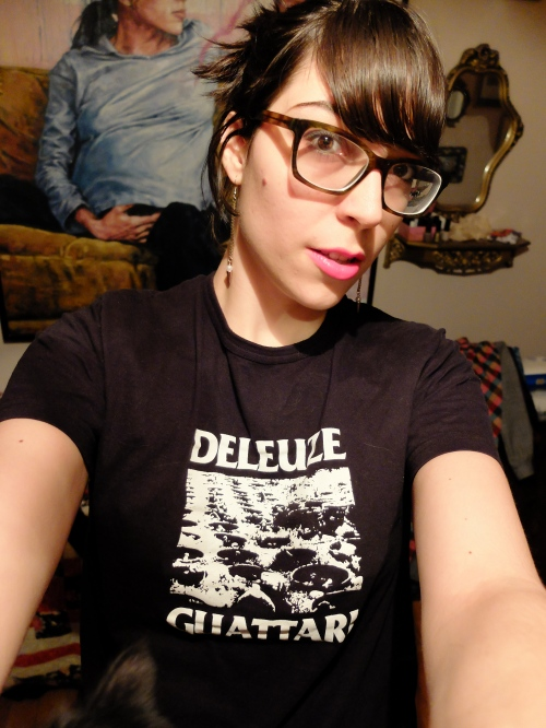 A selfie of the author wearing a Doctorak t-shirt that is a punk design of Deleuze and Guattari