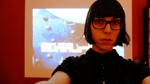 A selfie taken in my living room, with the opening credits from Věra Chytilová's 1966 film Sedmikrásky