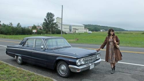 Julia posing next to her 1963 Mercury Meteor