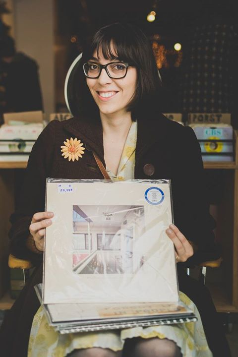 The author posing at Le Knock-Out on Record Store Day 2014 with her copy of Singer Songer by Michael Feuerstack